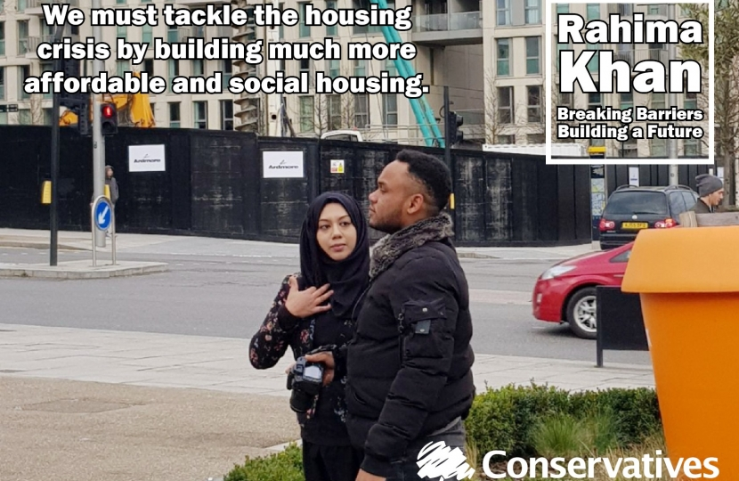 Rahima Khan and a supporter inspecting new homes